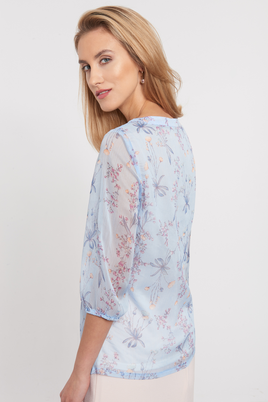 B³êkitna delikatna bluzka z kwiatowym wzorem