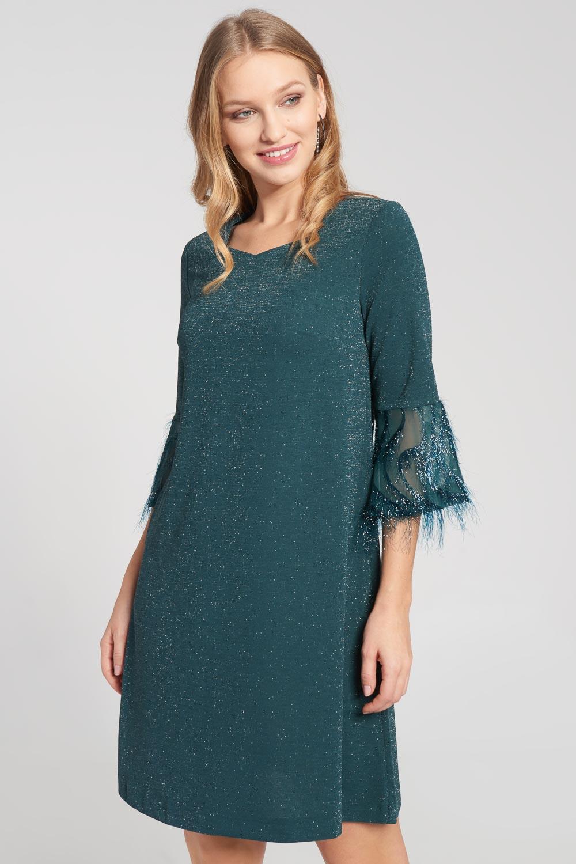 B³yszcz±ca sukienka w kolorze butelkowej zieleni